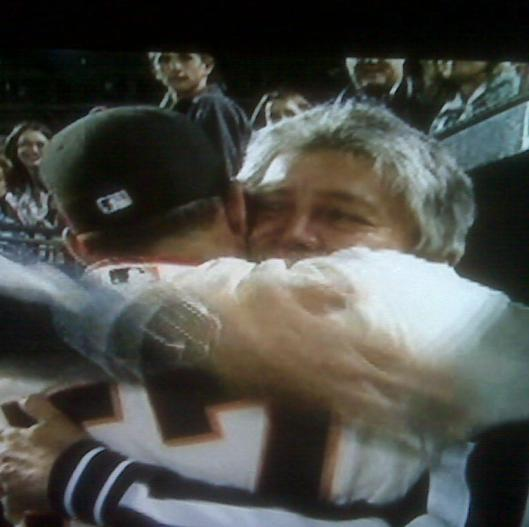 Giants pitcher Jonathan Sanchez hugs his father after pitching a no-hitter