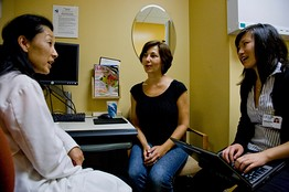 Patient Doctor Consultation with Decision Services Representative on hand