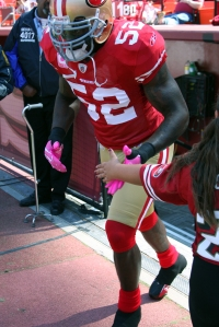 NFL All-Pro LB Patrick Willis sports his pink gloves and cleats