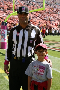 My son with the NFL ref sporting pink wristbands and ribbon